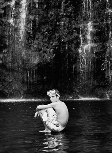 boy sitting on water